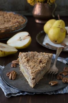 This homemade pear pie is perfect! Topped with a pecan streusel and full of fresh pears, you can use homemade or store bough pie dough.