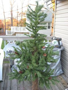 Use the branches of an OLD artificial Christmas tree and a cedar log to create a NEW smaller tree for in an apartment or small space. Recycled Christmas Tree, Christmas Tree Branches, Woodland Christmas, Old Christmas, Christmas Goodies, Rustic Christmas, Vintage Christmas, Christmas Holidays, Christmas Crafts