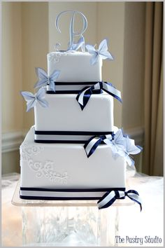 A Classic Navy and White Wedding Cake with Butterflies at Sunset Harbor Yacht Club. Congratulations Nicole and Jon.