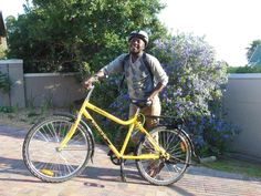Blessing and his bike. Don't you love his smile?