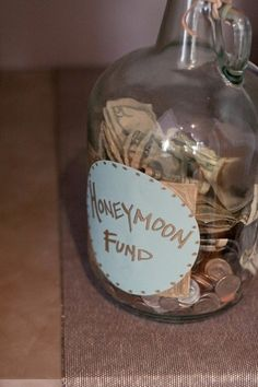 have a honeymoon jar at your wedding and see how much you get to spend on your honeymoon! fun idea :). Should also have one for loose change at home!