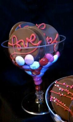Chocolate covered oreos and m's in a champagne glass perfect for a gift or favor made by cakepop popstars in New York