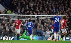 Manchester United goalkeeper David de Gea watches on helplessly as N'Golo Kante's fierce drive flies past him into the net