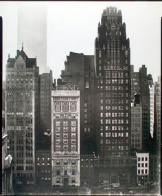 40th Street between Fifth and Sixth Avenues, Manhattan.    Notes: View from across the Bryant Park, incl. Scientific American, American Radiator Bldgs., corner of the library; Empire State Building beyond. Code: I.A.3.    Source: Changing New York / Berenice Abbott. (more info)    Repository: The New York Public Library. Photography Collection, Miriam and Ira D. Wallach Division of Art, Prints and Photographs.