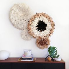 Natural and hand made juju hats for home decor Colors: White, red, gray, fuschia, blue, pink, purple, black, green, yellow, mixed white brown etc, sizes (length and inch) Large sizes 120cm(47in) Standard Sizes 80cm (31.5in) Small sizes 50cm (19.7in) Mini sizes 40cm (15.7in)