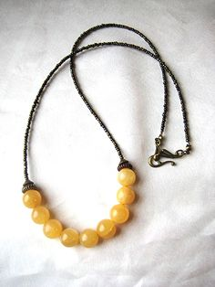 Long boho golden calcite necklace. These golden calcite spheres are incredible. Fantastic color, stunning luminosity, and it's like they catch the light and just glow! by WildThingsAdornments on Etsy