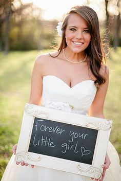 Take a sweet photo just for your mom and dad, and surprise them with a framed version after the wedding.