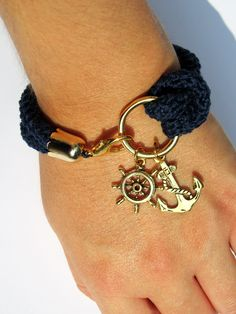 Nautical bracelet, navy blue crochet, rudder and anchor - made to order. $28.00, via Etsy.