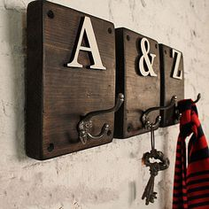 "Rustic letter hooks - wouldn't this look cute spelling out ""welcome"" in the entry?!"