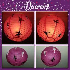 Lámpara de papel decorada con siluetas de bailarinas.