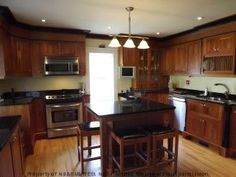 Gorgeous custom built cherrywood & cabinets with birds eye maple accents, granite countertops, custom built-ins, center island, window seats & more. View Listing Details
