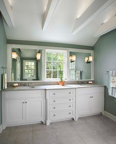 Nice style in this design, with two separate sink areas on a long counter.