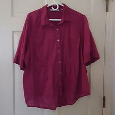Short sleeve burgundy blouse by The Avenue Lightweight button down short sleeve blouse.  This blouse has just enough elastic above the waist to add shape. Avenue Tops Button Down Shirts