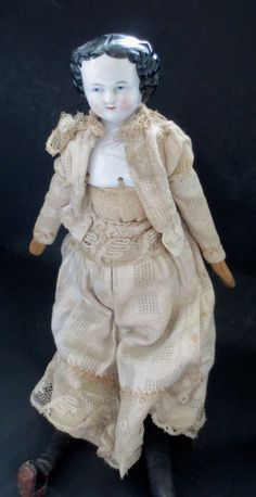 China Doll  Mid 19th cent. antiqueCloth Wood  Body Dress Blue eyes  Stand 14""