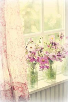 Breezy curtains, a sunny window, fresh flowers in glasses. Cheerful cottage!