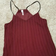 Deep maroon tank top Super cute chiffon like tank top. Pleated and loose,  and the fall of the straps makes shoulders look fabulous. Wear it with a strappy bralette to change up the look when wanted. I loved adding a cute cardigan when I wanted a classy but comfy style. Two layers to the top, the top layer being flowy. Perfect condition. Studio Y Tops Tank Tops