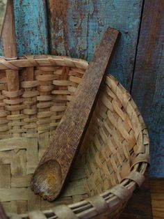Just makes me smile.  The color of the wall behind the basket, the color of the patina on the basket and the wooden tool....