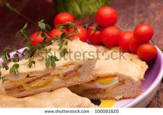 Sold! Stock photo available for sale at Shutterstock: Neapolitan Easter Traditions - Cuisine - Pizza Rustica also called Pizza Chiena is a stuffed pie. - stock photo