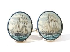"Handmade sterling silver scrimshaw cufflinks. Handmade scrimshaw cufflinks by Jenkins with scrimshaw by Judge on ancient mammoth ivory. We do not get many of these Judge cufflinks anymore, but whenever we do they are always first rate. Great work, as usual.  Size: 3/4"" Diameter  Price: $275.00 -- on ScrimshawGallery.com #cufflinks #jewelry"