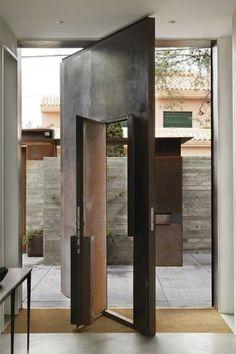 amazing exterior #door inside a door; smaller door opens on hinges while the large door (size of entry wall) pivots
