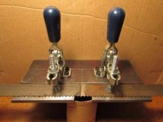 Bandsaw Blade Repair Jig - Homemade bandsaw blade repair jig intended to secure bandsaw blades for brazing. Constructed from toggle clamps, angle iron, and hardware.