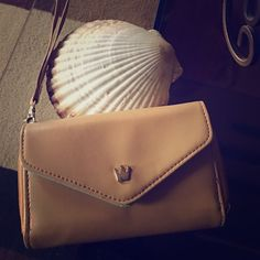 Adorable wristlet Sweet wristlet that I used one time. I have the IPhone 6s Plus now so it won't fit inside. Would love to find a new loving home. Beautiful mint interior with an exterior tan combo. Lots of room. Bags Clutches & Wristlets