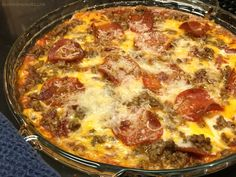 Pizza Dip makes great party food! All the flavors you love in a pizza, in a dip that can be eaten with crackers, chips, bread, celery sticks...you name it.
