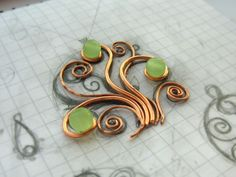 A little lesson on how to make a pendant tree of copper wire and make a patina on copper using ammonia.