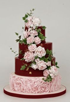 Marsala and pink wedding cake with english roses and ivy