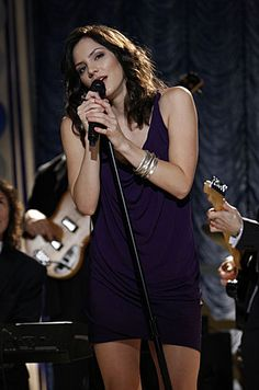 "Karen singing at the party.  Needs to be less ""nice"" and far more complex to be interesting in the series."
