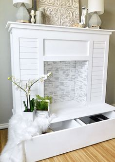 If you don't have a fireplace, build one! This DIY faux fireplace features cute, on-trend shiplap, limewashed faux brick and even extra storage space.