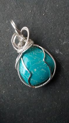 Check out this item in my Etsy shop https://www.etsy.com/listing/269202250/arizona-turquoise-sterling-wire-wrapped