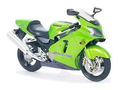 The Tamiya 1/12 Kawasaki Ninja ZX-12R is a plastic model kit in the Tamiya 1/12 Motorcycle Plastic Model Kits range. Kawasaki's legacy of cutting-edge sportbikes has inspired motorcycle fans for generations. As a special feature for this model, semi-transparent green parts have been used for the fairing, offering a fascinating look at the aluminum monocoque frame and detailed engine, even after completion of the model!