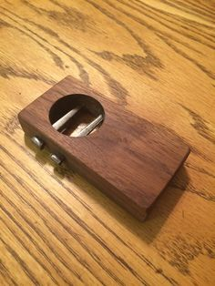 Made from wood and cut nails, finished with Danish oil. Includes a magnet on the back to keep it on the refrigerator.
