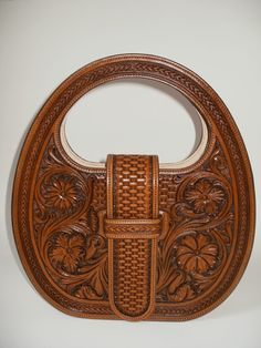Hand tooled bag by French saddler Jean-Luc Parisot, Parisotsellier.com