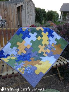 Jigsaw Puzzle Baby Quilt (Free Pattern Included) how cute is this? Old baby clothes for boys?