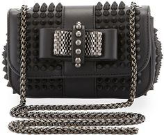 $1,395, Black Studded Leather Crossbody Bag: Christian Louboutin Sweet Charity Small Spiked Crossbody Bag Black. Sold by Neiman Marcus. Click for more info: https://lookastic.com/women/shop_items/214030/redirect