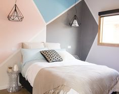 Love the pattern and paint colours on this wall. Love how it spreads over a corner too. I want to do this in one of the kids rooms. House Rules 2015 - Bronik and Corrine Whole House Reveal - Guest Bedroom