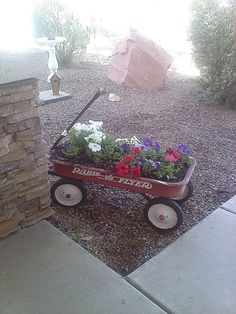 Wagon Flower Bed for small yards and creative decorating. I have one of these at the end of my deck and I love it! I change the flowers out yearly for a different look!