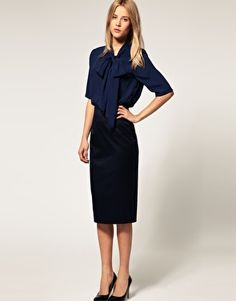 silky soft blouse w high waisted skirt- This would also be appropriate for a front of house manager.