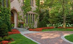 traditional brick driveway near potted plants