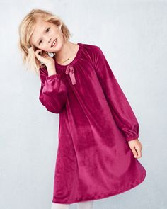 Add a little luxe to her life with our soft-and-sweet velour dress. Featuring a flowing A-line shape, pretty bracelet-length sleeves, and easy elastic scoop neck (with bow!) and cuffs.