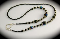 Beaded eyeglass chains can not only be functional but beautiful pieces of jewelry. I like to create jewelry style beaded eyeglass chains using sterling silver, pewter, gold-filled and Czech glass… Beaded Necklace, Beaded Bracelets, Black Fire, Eyeglass Holder, Necklace Holder, Czech Glass Beads, Fashion Jewelry, Women's Fashion, Eyeglasses