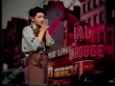"""""""Paris, Tu Mas Pris Dans Tes Bras"""" (Paris Au Yem) -Julie (formerly known as Julie Quang) shows here on this music video her exceptional singing abilities in both French and Vietnamese languages."""