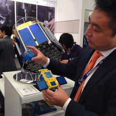 Yasu Yamazaki demonstrates Astroscale plan to clean up #spacedebris - with a secret glue-laden satellite - using a model built of #nanoblocks - story coming soon on CNN.com #pas15 #salondubourget