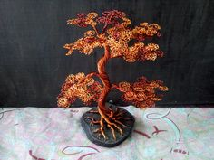 Handmade wire tree on base of tree trunk
