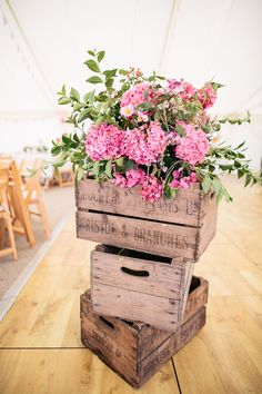 Wooden crates make a great rustic stand for a flowers. Wooden Crates Wedding, Vintage Wooden Crates, Wood Crates, Rustic Flower Arrangements, Rustic Flowers, Fake Flowers, Flower Decorations, Wedding Decorations, Table Decorations
