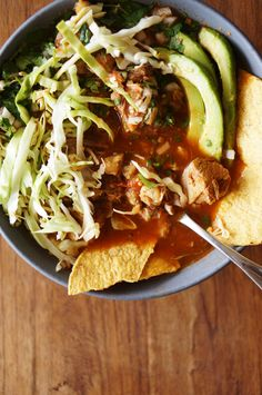 Pozole is comfort food at its finest-- a steaming bowl of tender pork and hominy in a deep red but light chile broth. My good friend Ofelia first introduced me to this Mexican stew and I instantly fell in love.Pozole isher dish. Any time she has a day off, she'll make a big pot of pozole. Like