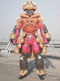 A master of the Toad fighting style, Toady is perceived the least menacing of the Five Fingers of Poison. However, he can form a near-impenetrable shield and throws ball bombs at his opponents. He is head-over-heels in love with Stingerella. Camille uses this love to get both to work together with Toady as defense and Stingerella as offense. Toady is destroyed when his barrier is penetrated by a shot from the Jungle Fury Rangers' newly pristine Claw Cannon. He and Stingerella were later...
