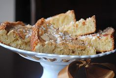 Almond cake - the cake looks like is good and super easy to make, but I LOVE the cake stand with the ribbon tied through it!
